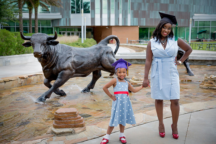 mother and daughter at usf graduation by Bull fountain